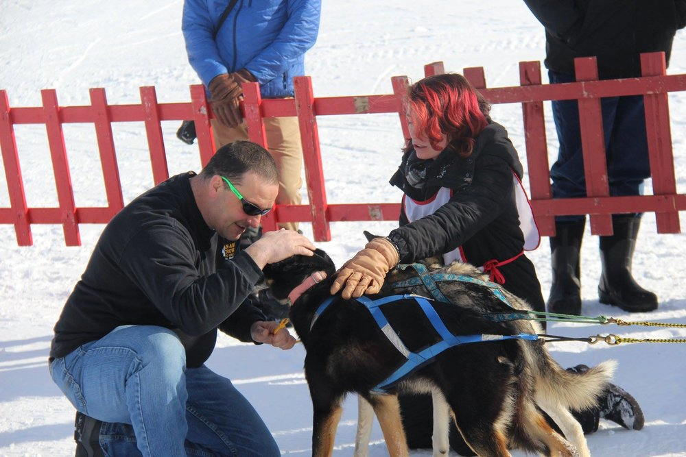 A spectator pets Hannah's dogs during the 2019 Can Am Crown 30