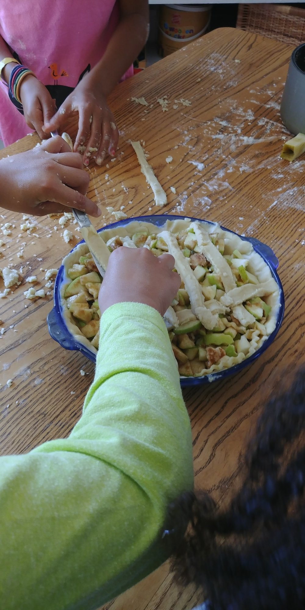Young hands work together to build community - and pie!