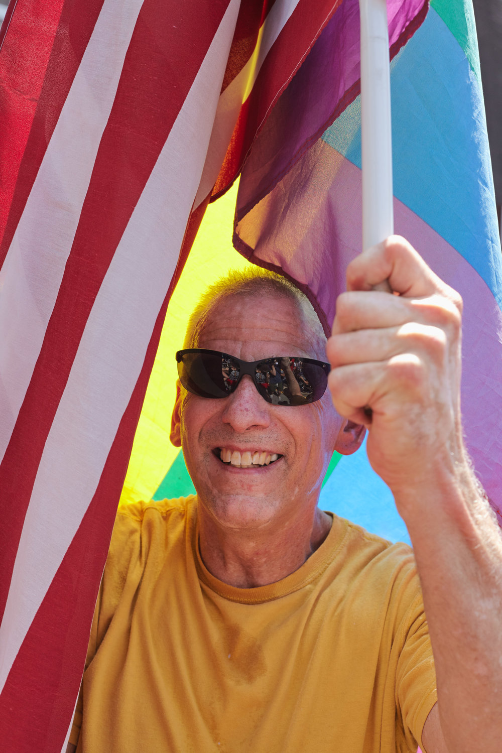 A Big Gay Dance Party attendee shrouded in flags.