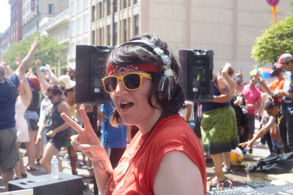 DJ Moxie plays music during the Big Gay Dance Party