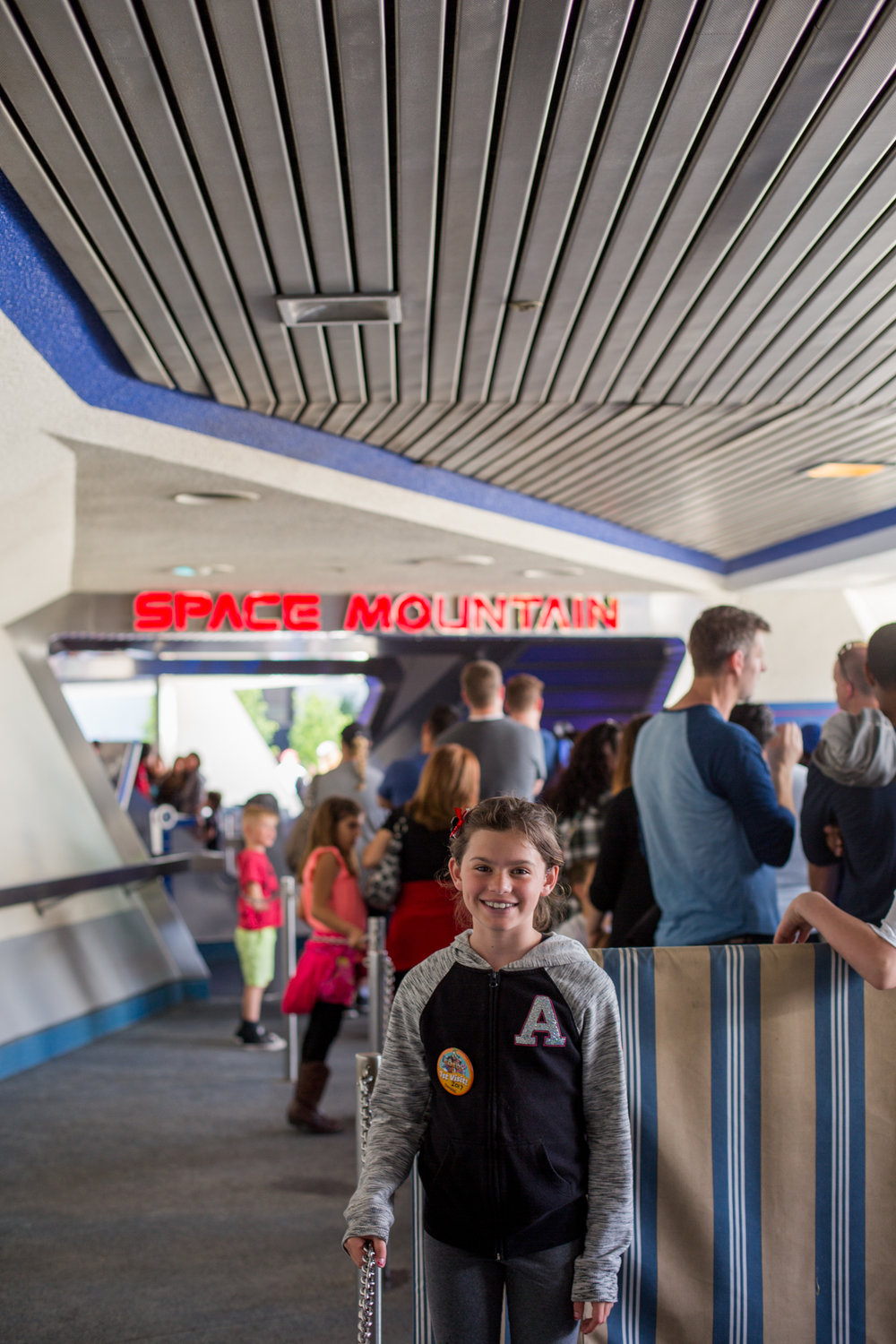 A mixture of anxiety and excitement as we waited in line for HyperSpace Mountain!