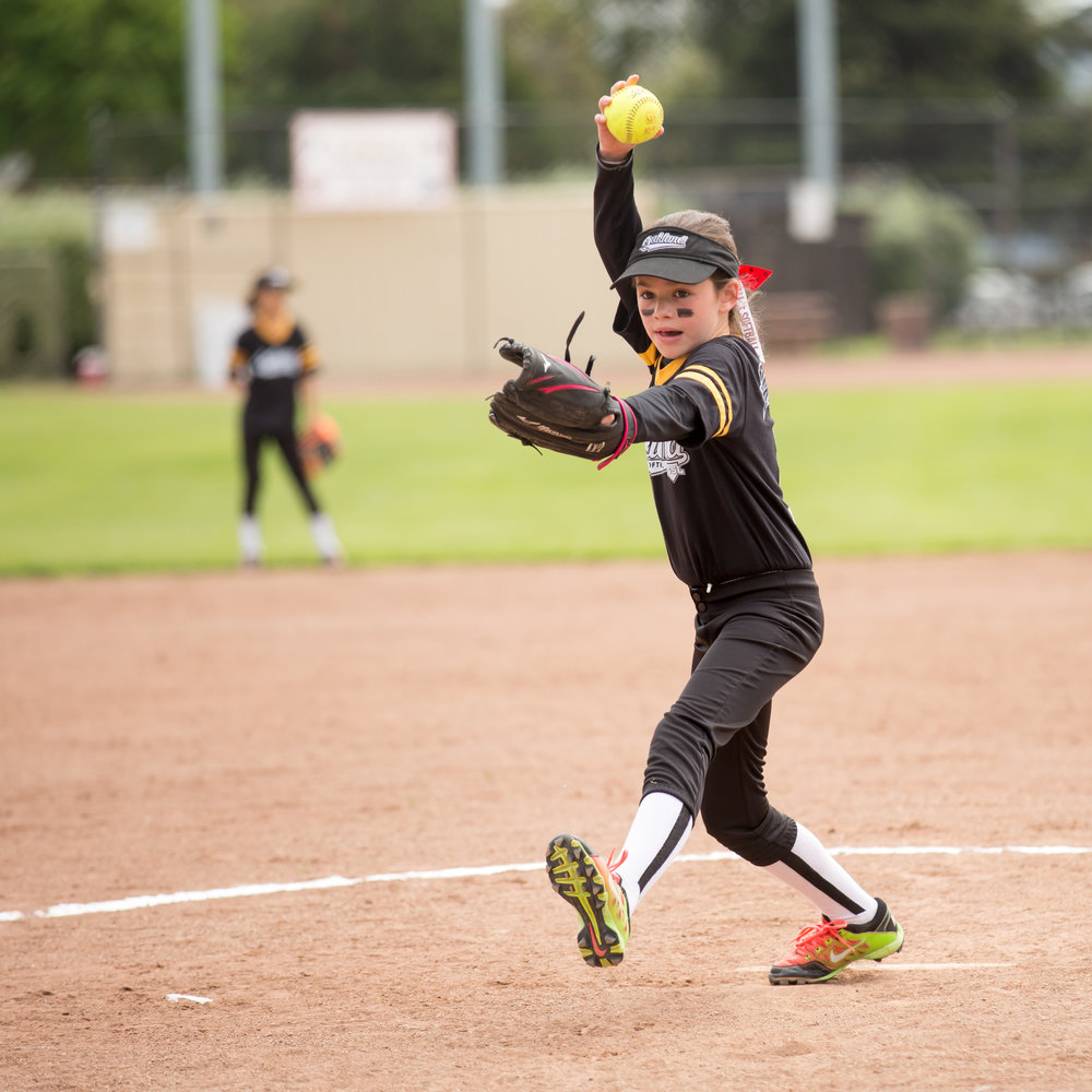 image_girl playing softball_lori fuller photography