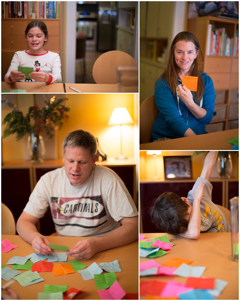 Family members read notes of gratitude as part of family tradition.