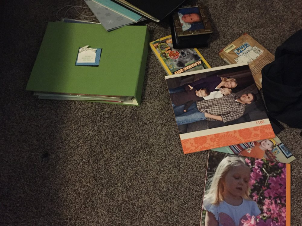 "My son's bedroom floor is sprinkled with half a dozen photo books and scrapbooks that contain all the pictures that tell the story of his parents in college, his Grandparents, his life as a baby and toddler.  He turns the pages of those books almost every single night - I gave up on making him put them back on the bookshelf.  I do not consider myself great at home decor - interior decorating just isn't where my talents lie.  I do, however, make sure that there are pictures of our family hanging in nearly every room of our home.  I know we live in a digital age and everyone wants to share pictures online, but I still firmly stand in the land of the printed image.  And based on the reactions my children have and how much they love to look at old pictures, I'm glad I have stuck with the hassle of printing images.  I got my Bachelor's degree in Psychology, so it's not big surprise that I am intrigued by learning the effects of different stimuli on the brain.  It's become increasingly interesting to me since I had my children and I am forever trying to make sure they have self confidence and know that they belong in our family.  I stumbled upon a few articles recently that discuss how having pictures of themselves hanging on the walls of the home can help boost a child's self esteem.  Judy Weiser, a psychologist and art therapist from Vancouver, says this about displaying pictures in the home, """"They learn their genealogy and the the uniqueness of their own family and its story. When a child sees a family portrait with them included in the photograph they say to themselves:  'These people have me as part of what they are, that's why I belong here. This is where I come from. '""  Don't we all just want to feel like we belong to someone or something?  It's human nature.   ""Touching the photograph where a face is smiling or the shoulders, it is the same thing as touching a book when you read it.  There's a lot of stimulation of the brain when you have that sensory experience. That is a bit lost in the move to digital. You are touching a keyboard, mouse or a touchscreen but you are not touching the image,"" says Craig Steinberg, a licensed psychologist who works with children ages 5-13.    There are so many other experts who have chimed in on this topic, but I have the proof that what they are saying is true living in my own home.  This is why I continue to encourage and offer print packages with my sessions.  It's tough to build confidence in such a crazy and negative world, but within the walls of our home is where we can have the most impact.  Hanging a picture you love is such an easy way to get your family out the door on a positive note."