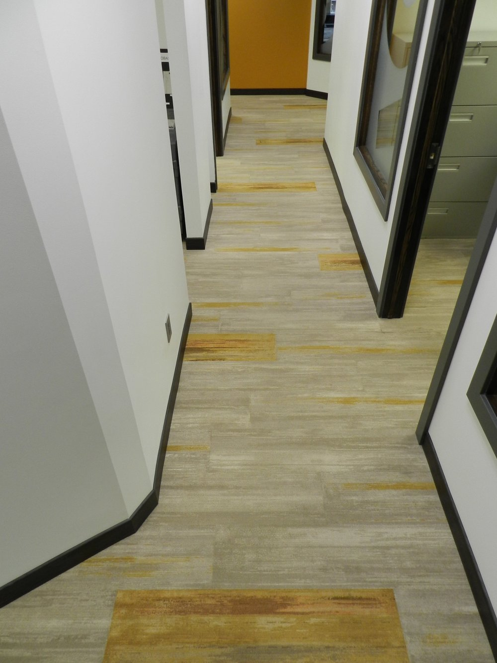 Milliken's color field carpet tile is a staff favorite for good reason. Its uber-durable and has such a fun color pallet. We knew this would be a perfect fir for the Obassa team.