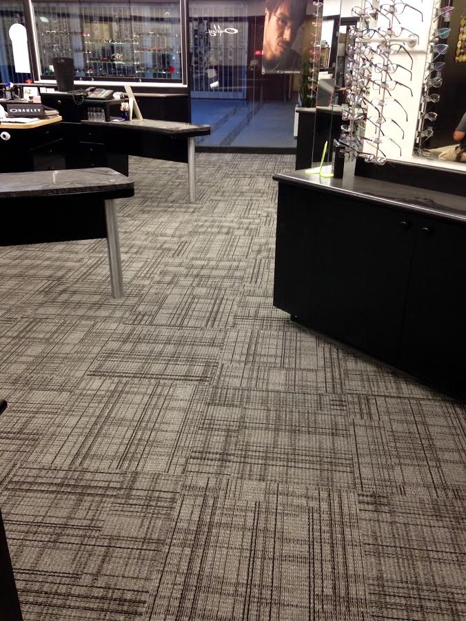 Carpet tile is a great option for commercial spaces, its quiet, quick to install and really easy to replace portions that get worn.