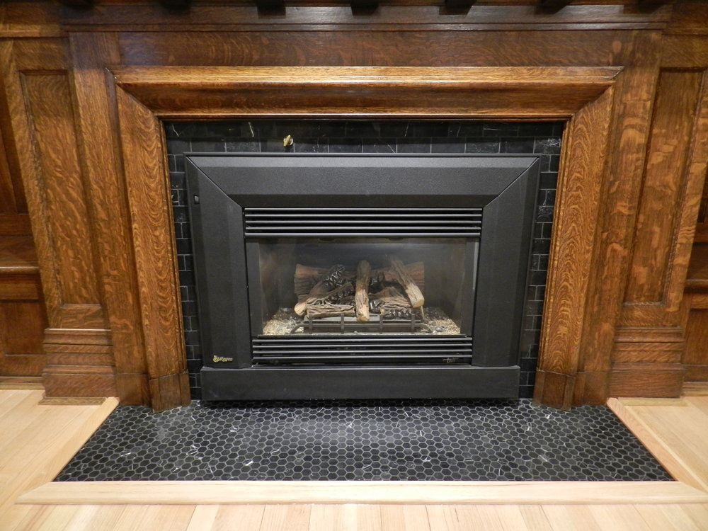 We worked with designer Edie Reikman to re-tile the three main floor fireplaces. All three had different tile that did not coordinate with one another. Now the three work together with the entry. Its elegant and simple.
