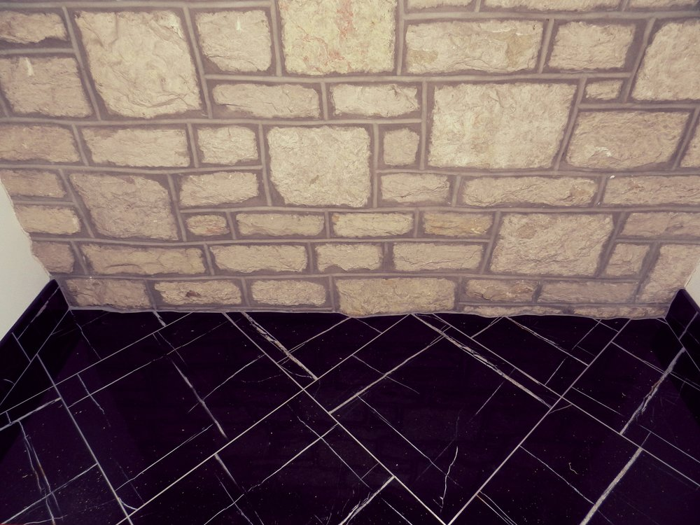 China Black entry tile is a statement with every step. The natural marble is a perfect contrast to the iconic University of Saskatchewan greystone. Marble is a 'forever option' for an institution that will be around for at least a few more years.