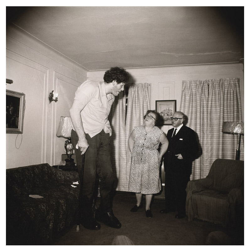 Diane Arbus (b. 1923, New York; d. 1971, New York) A Jewish giant at home with his parents in the Bronx, N.Y.C., 1970 Gelatin-silver print 15 x 15 in. The Museum of Contemporary Art, Los Angeles The Ralph M. Parsons Foundation Photography Collection