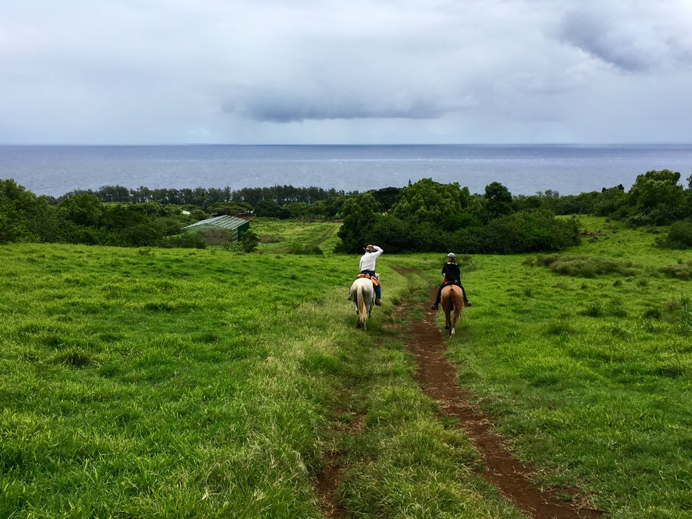 Meriwether riding with Hana Ranch Manager Duane on Maui.