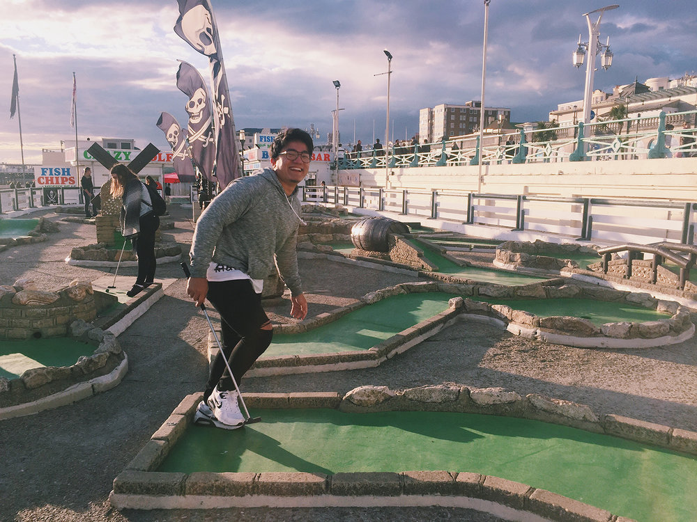 Playing miniature golf on the beach in Brighton