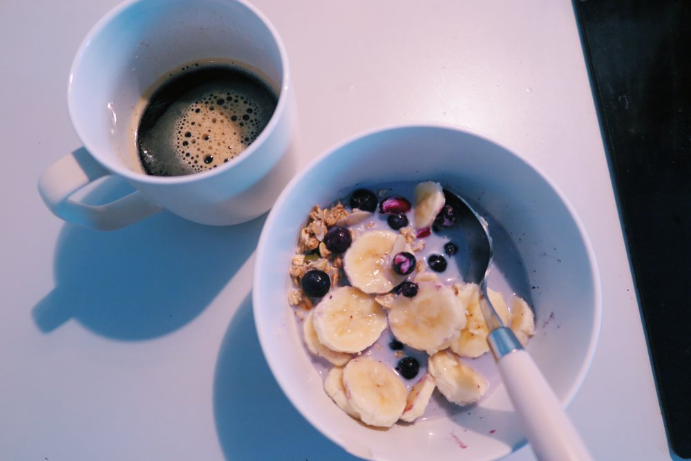 4.  Super berry granola + soya milk + sliced banana + blueberries with black coffee