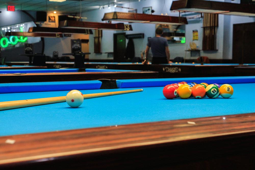 Teens have pleasure on the pool table