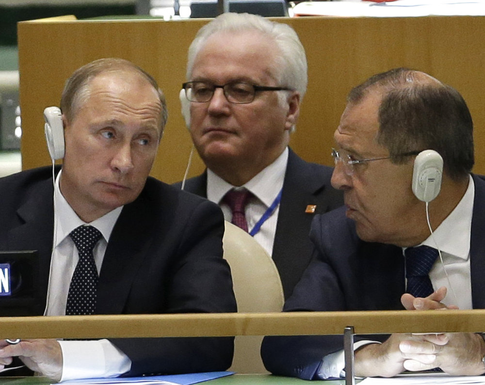 Russian President Vladimir Putin in an undated photo at the United Nations with his permanent representative to the United Nations, Vitaly Churkin, who died of cardiac arrest in New York in February 2017. Also pictured, at right, is Russian Foreign Minister Sergei Lavrov.