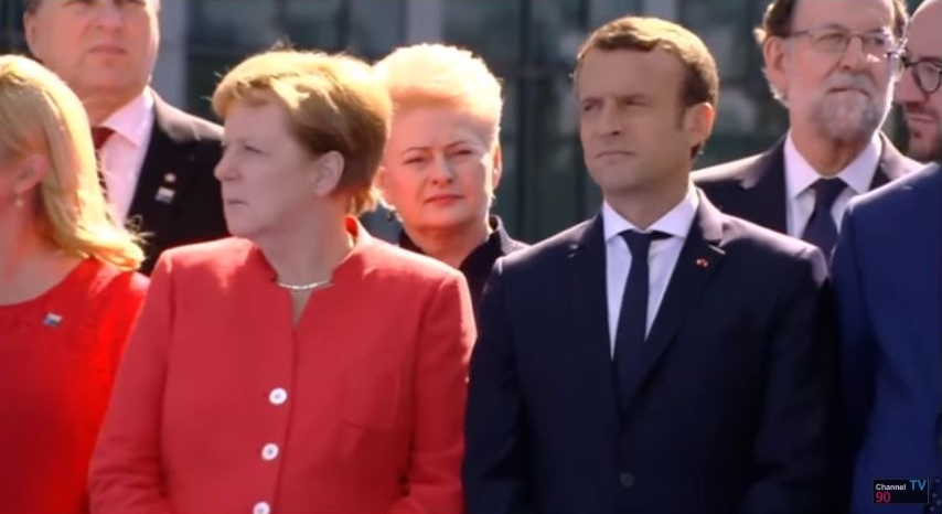 German Chancellor Angela Markel looks at the piece of the Berlin Wall at NATO headquarters in Brussels that was installed there along with a piece of the North Tower of the World Trade Center, May 25, 2017. To her left is newly elected President Emmanuel Macron of France, and behind her is Lithuania's President Dalia Grybauskaite, Croatia's President Kolinda Grabar-Kitarovic