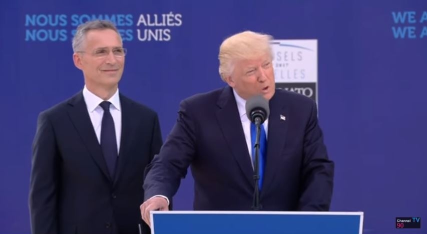 NATO Secretary General Jens Stoltenberg looks on as President Donald Trump addresses the heads of state of the alliance, May 25, 2017.