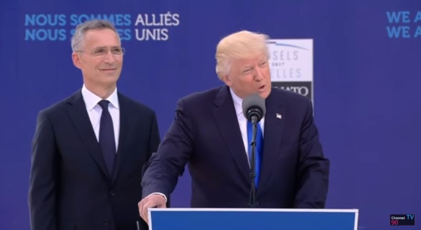 NATO General Secretary Jens Stoltenberg smiles after Trump says he didn't ask how much the new NATO headquarters cost.