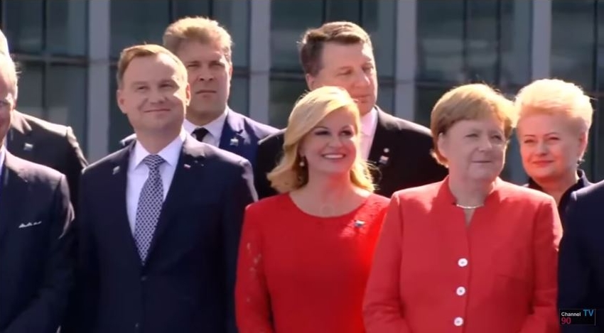 A screen grab moments after Trump's joke about NATO headquarters. Flanking Angela Merkel are Croatian President Kolinda Grabar-Kitarovic and Lithuanian President Dalia Grybauskaite.