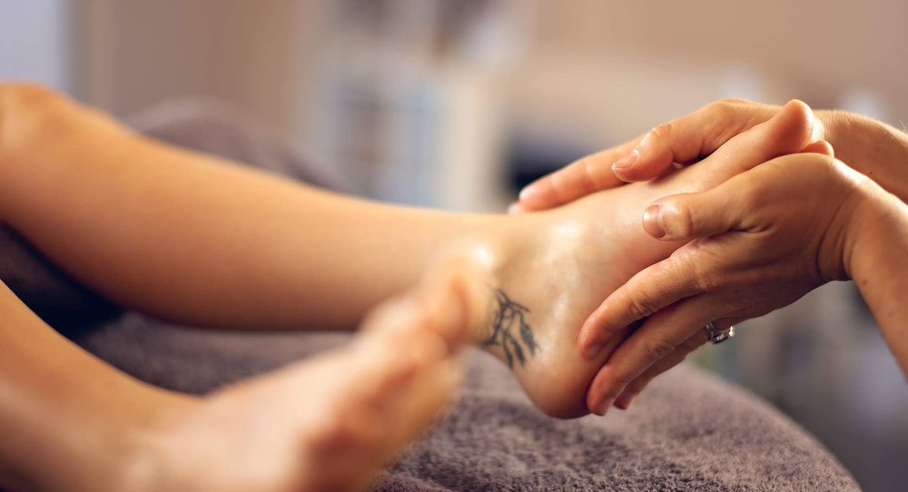 reflexology and holding feet