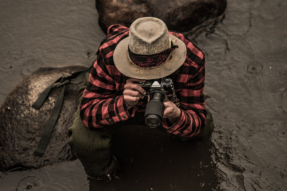 "A man and his camera creating ""art"" out in a cold rainy environment during the winter month of January high in the rocky Mtn's. We do these things not because we have to but because we love to… ""Take only pictures, leave only footprints"" are great words to live by. It can also be considered a practice. Relish your environment."