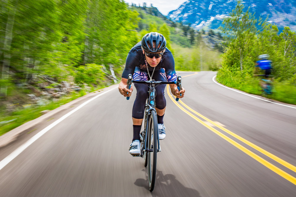 Having been inspired by a well know action sports photographer Scott Markewitz a few years ago. Marewitz, had taken an image similar to this for a brand ad. That image stuck with me for years and give me the desire to have a friend drive my truck up and down Independence Pass photographing local athlete celebrity Greg Strokes. As rolled around in the back of my picking up trying to match shutter speed to desired effect, manage my semi-working flash, angles, have my wild man driver go an exact speed, we managed to navigate the narrows of Independence Pass. Image all of this to re create a look/image I saw years before. The challenge of getting a shot like is what made me want to do it. The Aspen Photo Challenge, a photography competition created the desire to go for it... Not sure why I hadn't before, but am happy that is is out now. Look forward to another shoot similar to this in the feature.