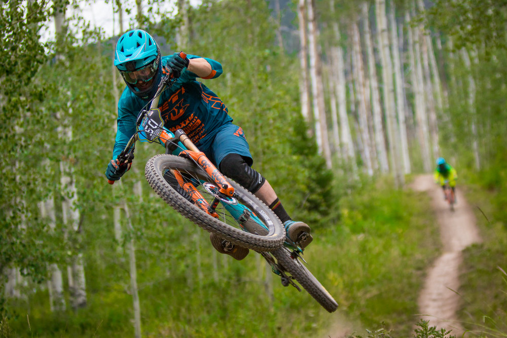 Flying off the lip of a jump on the infamous Valhalla trail in Snowmass, Colorado. This image was taken during the only North American stop for a popular mountain bike racing called the Enduro World Series also know as the EWS.