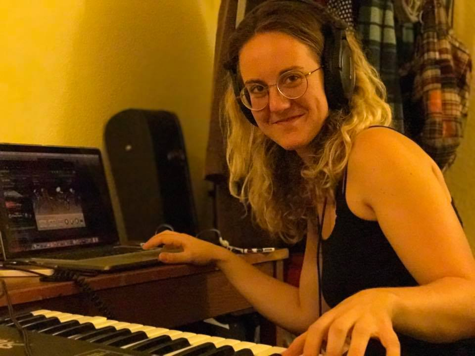 Sarah recording at her home studio