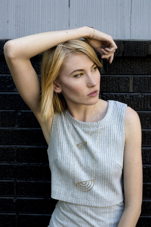 Model and jewelry designer MelaMosey poses for photographer Lillian Short in Portland, Oregon.