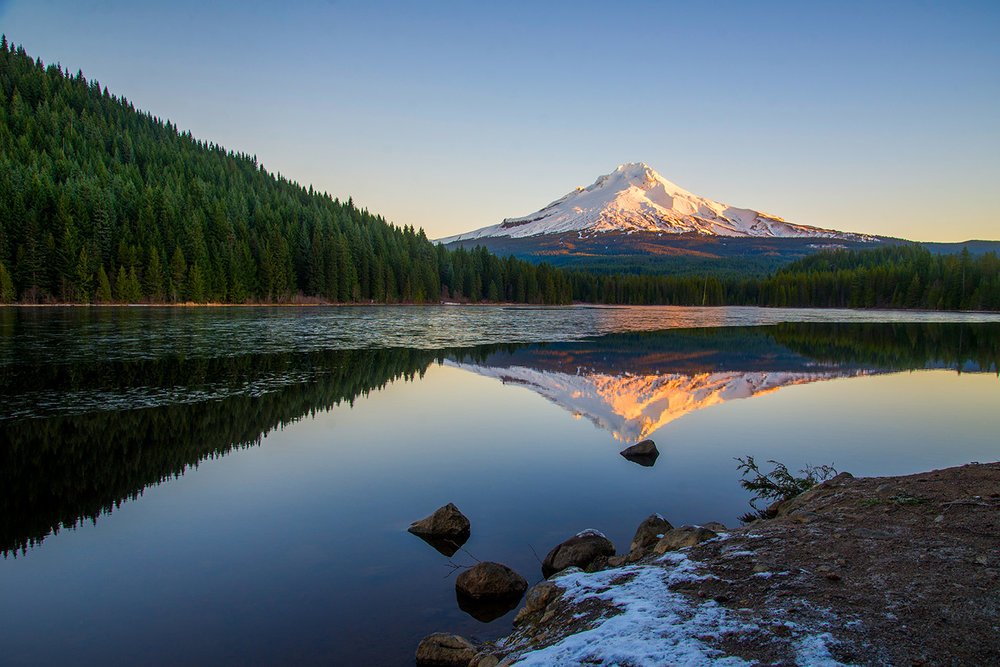 Mount Hood reflected in Lake Trillium on a December morning in Oregon. Photographed by Lillian Short.