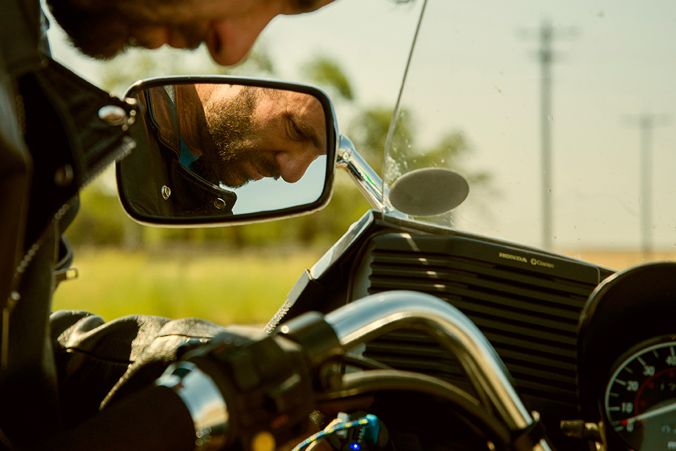 Portrait of mechanic working on his Honda Silverwing  GL 500 in Eastern Oregon. Photographed by portrait photographer Lillian Short.