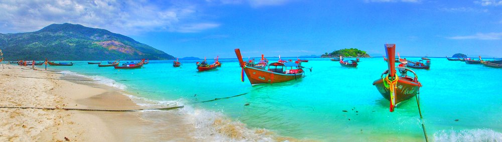 Thai longtail boats on Sunrise Beach, Koh Lipe Thailand. Travel to Thailand's most beautiful island.