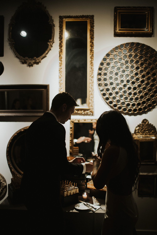 Dark and Moody Wedding Cake Cutting Photos