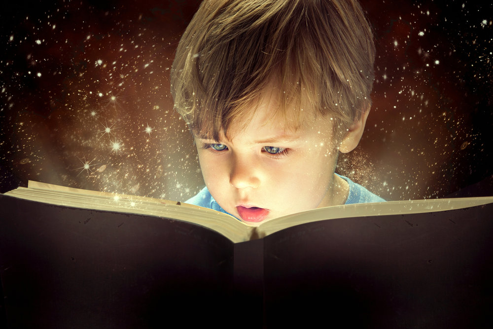 bigstock-Child-opened-a-magic-book-59529455.jpg