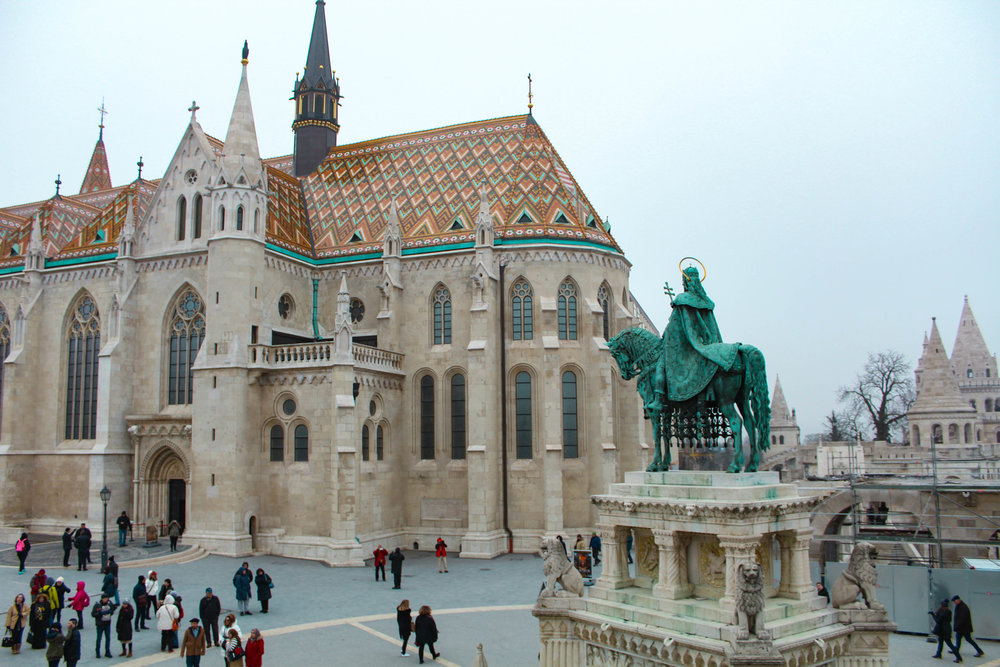 Matthias Church (supposedly first built in 1015, though there is no archeological evidence to confirm) and statue of St. Stephen, founder of the Magyar state and first King of Hungary.