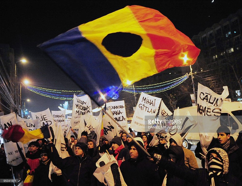 A flag at the 2017 protests as a symbol of the 1989 revolution. Photo credit: Getty Images