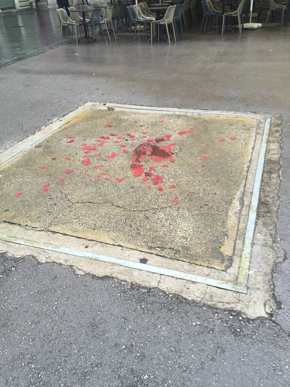 A Sarajevo Rose: marks left by mortar shells have been filled with red resin in memoriam of the siege of Sarajevo which lasted four years, making it the longest siege of a city in modern hisotry.