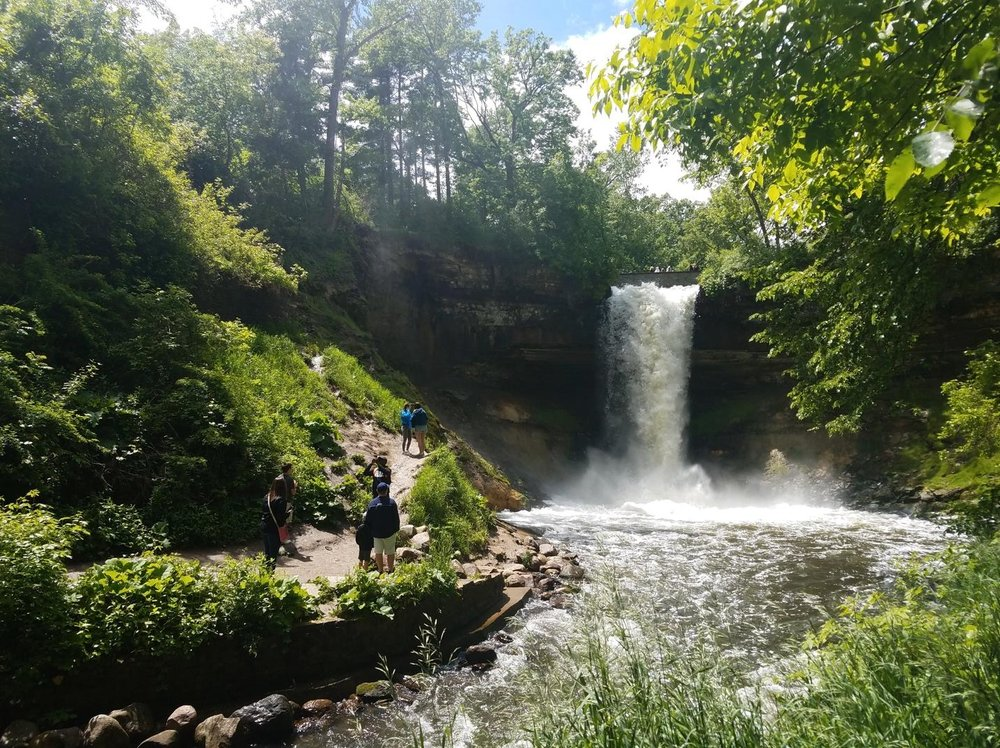 The beautiful Minnehaha Falls. Guests of all ages can find a trail suitable for their level to hike through the beautiful forest surrounding the falls. It's a great place to see – rain or shine!