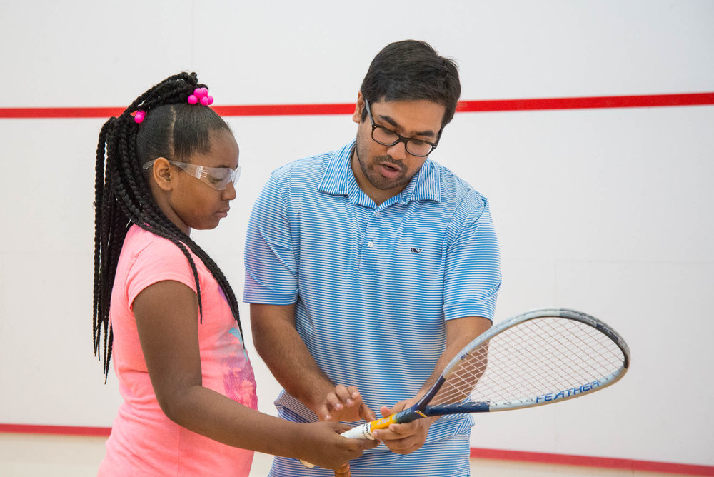 Coach Vir Seth helps Katie Whitt through proper technique during practice at the Cincinnati Squash Academy Monday May 8, 2017.