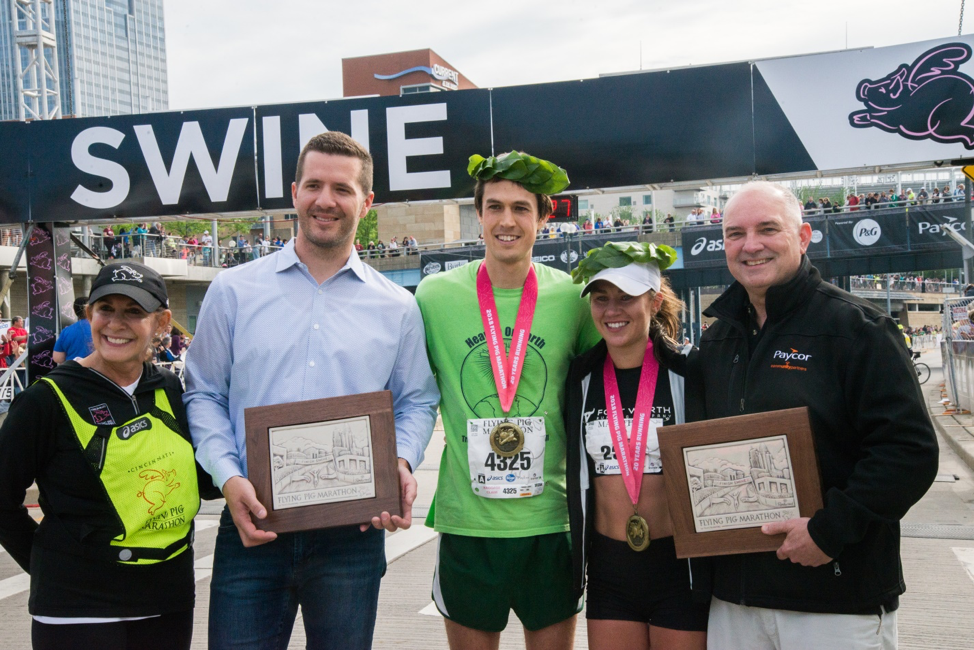 Iris Simpson Bush at the Finish Swine at this year's race presenting the Rookwood Pottery plaques to the marathon winners.