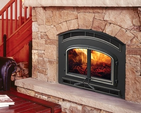 Quadra-Fire 7100    View Full Specs   The tall arched opening of the 7100 provides a beautiful view of the four-point combustion technology burn. With the capability to add up to two remote Heat Zone systems, the 7100 allows for heat distribution throughout the home. Decorative firescreen and trim options are available.