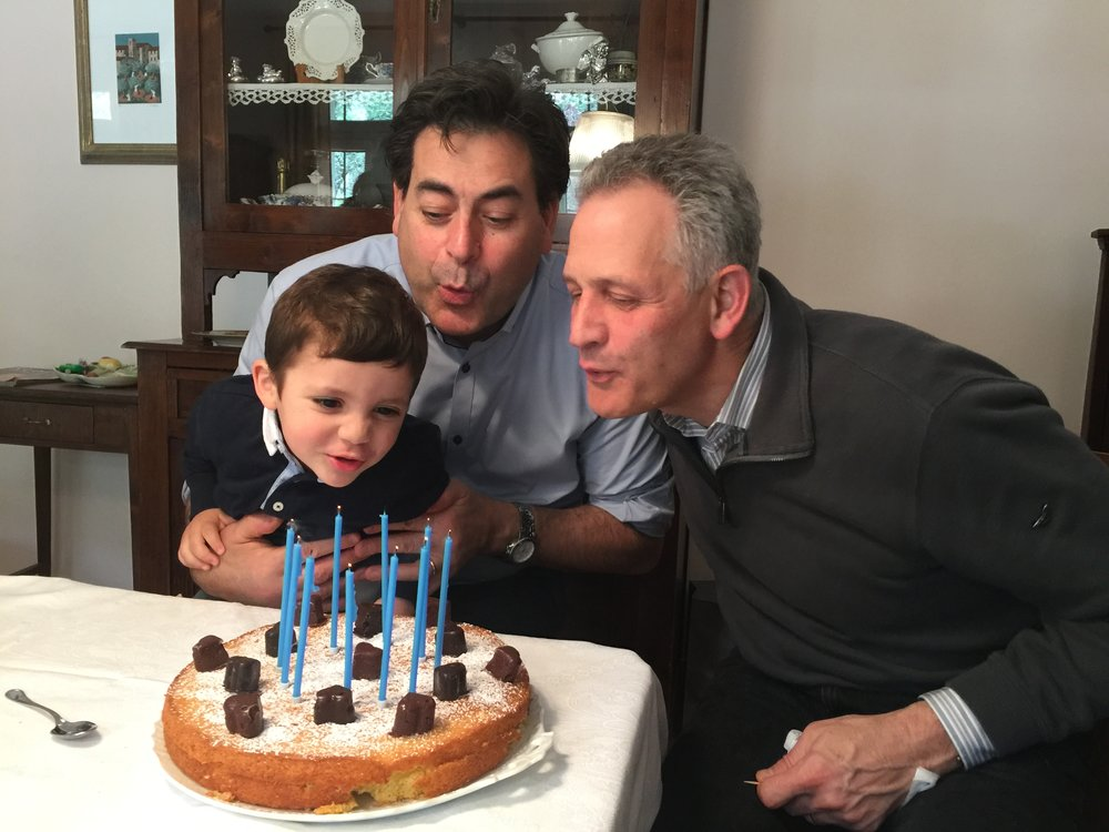 My colleague, Paolo Trasciatti and I share a birth date. Here we are celebrating with his family.