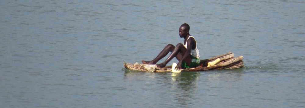 Young man from Kokwa Island paddling his ambach canoe