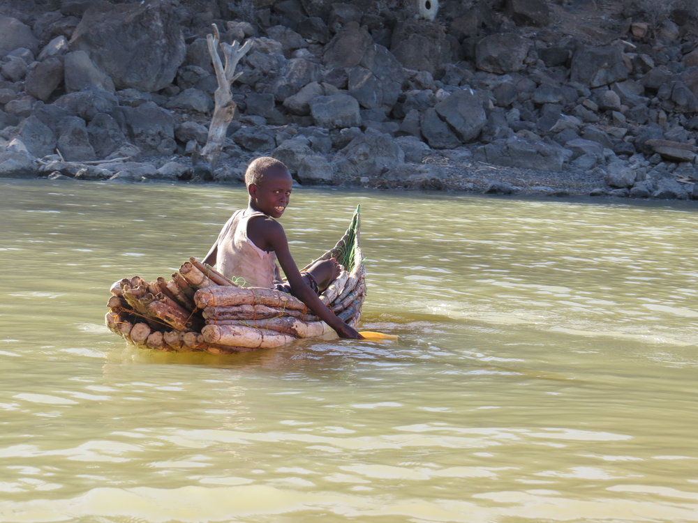 Il Chamus boy paddling his canoe in Lake Baringo