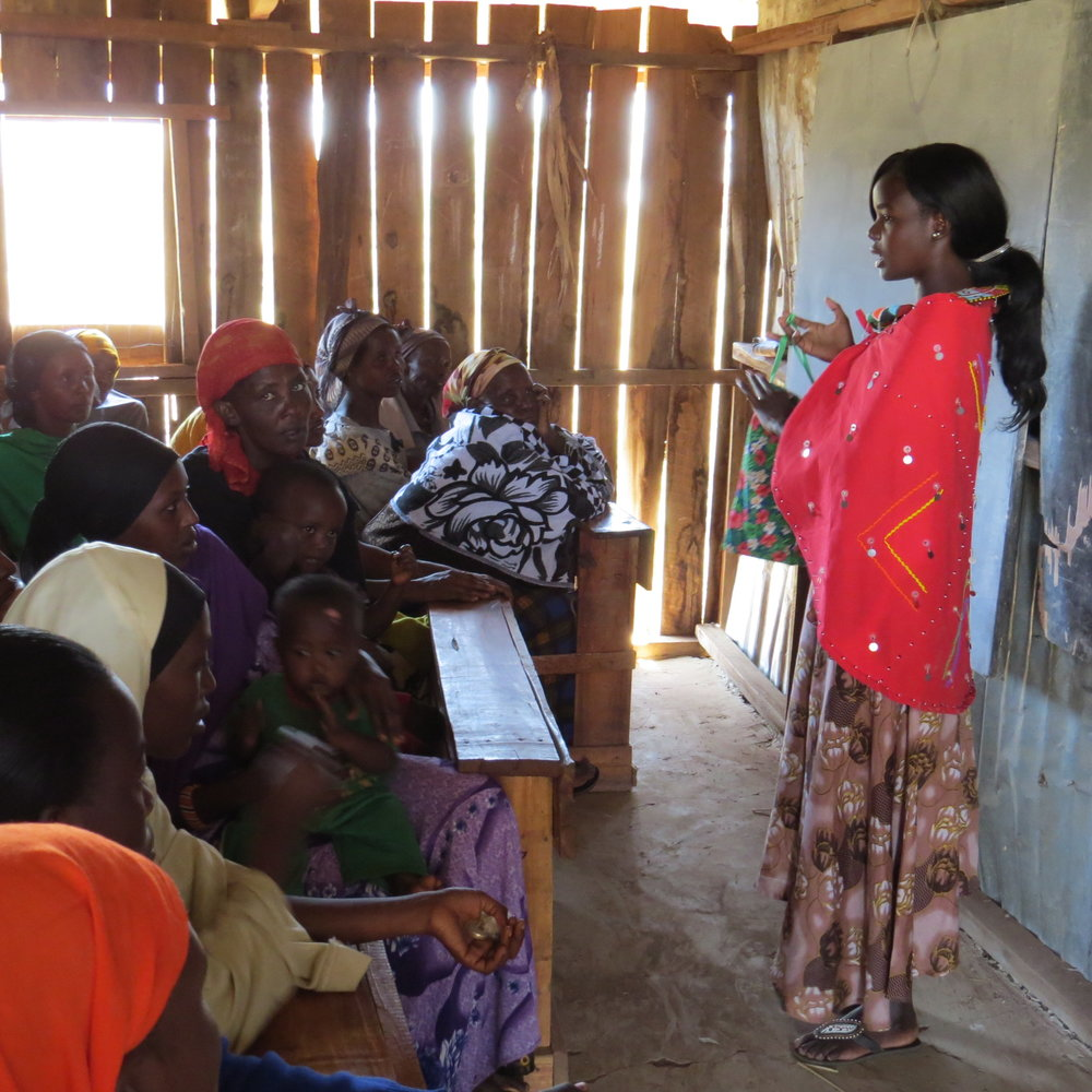 Irene Lechingei teaching students and their moms about Days for Girls hygiene kits