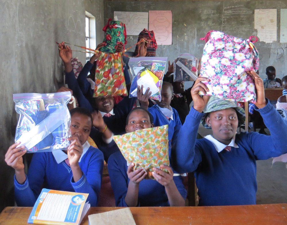 Students with hygiene kits from Days for Girls