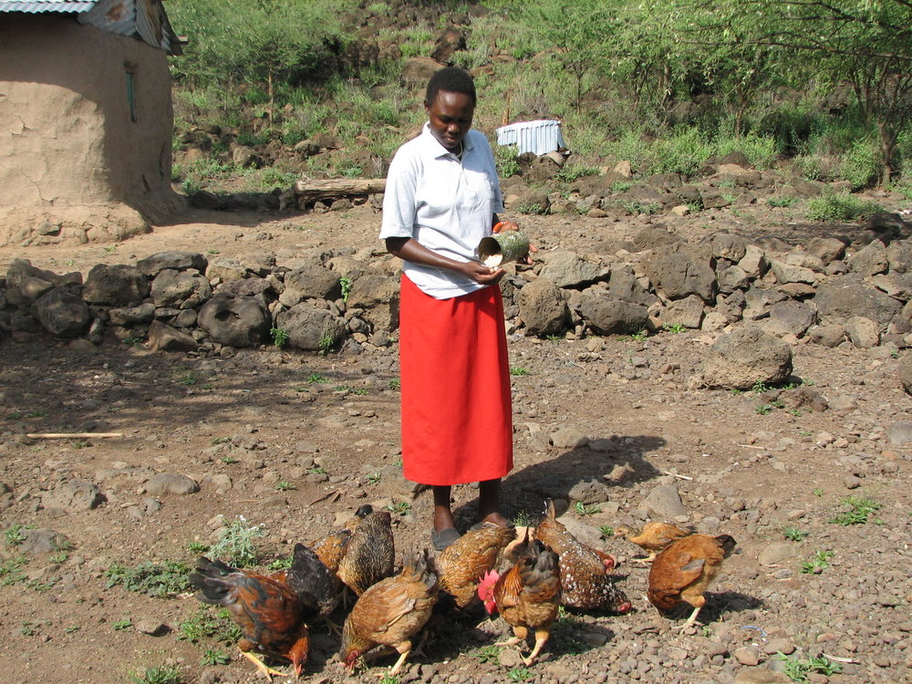 Grace Koinale with her chickens
