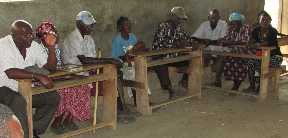 Samuel Muhunyu facilitates a meeting of the AKASE Self-Help Group, beekeepers and entrepreneurs on Kokwa Island