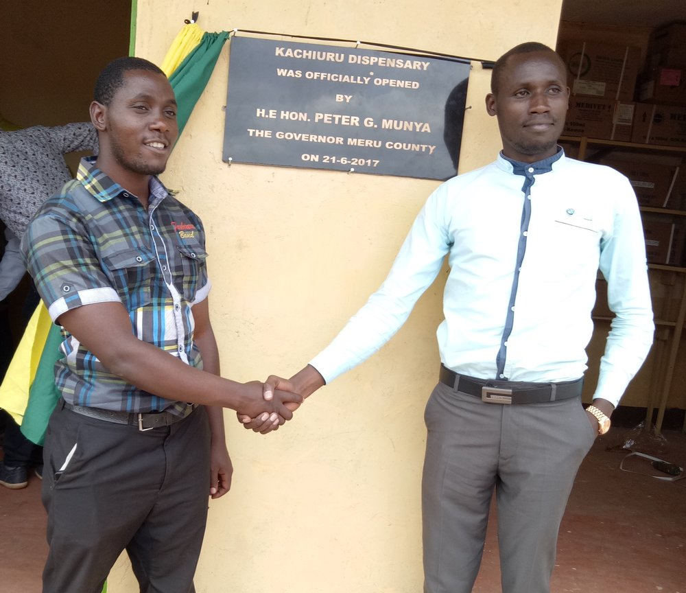 The Nurse and the Clinical Officer after the ribbon cutting