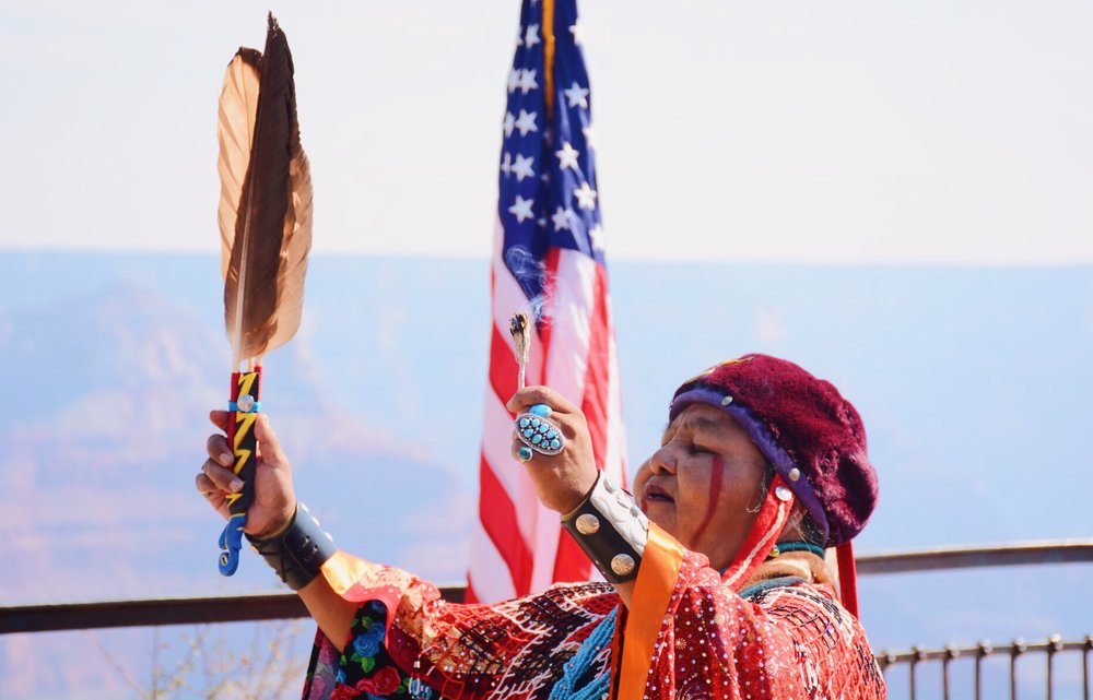 A member of the Havasupai Tribe performs a traditional ritual during a naturalization ceremony in August at Grand Canyon Natural Park. (Photo by Bri Cossavella/Cronkite News)