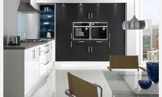 Blank and white gloss cabinets. High end look, low end price. We have 33 colors: start creating. #kitchens #modernkitchens #lowcostkitchens#greatcabinets